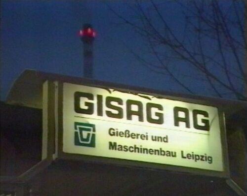 Schild der GISAG AG am Abend